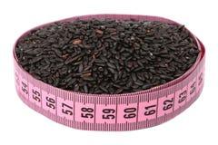 Svart rice och mäter Arkivbilder