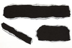 svart sönderrivet papper som isoleras på vit bakgrund Royaltyfria Bilder