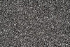Svart sandbakgrund och textur arkivfoto