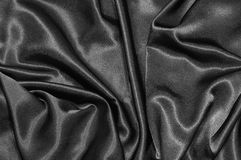 svart satäng för bakgrund Arkivfoto
