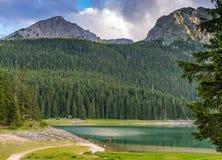 Svart sjö i aftonen Durmitor Royaltyfria Bilder