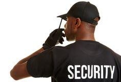 Svart säkerhetsman med radiouppsättningen Fotografering för Bildbyråer