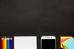 Svart skrivbord för skola eller för kontor Arkivfoto