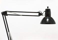 svart skrivbordlampa Arkivfoto