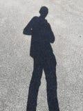 Svart skugga av en man walking4 royaltyfri fotografi