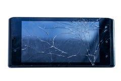 Svart smartphone med brutet exponeringsglas royaltyfria foton