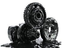 svart smutsad kugghjulolja arkivbilder