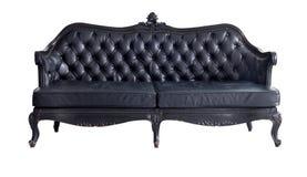 svart sofa Arkivbild