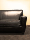 svart soffa Arkivbild
