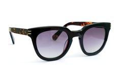 svart solglasögon Arkivfoto