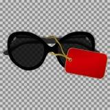 Svart solglasögon med etiketten på en genomskinlig bakgrund Arkivfoton
