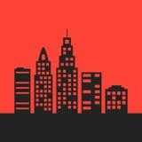 Svart stadslandskap på röd bakgrund Arkivbild