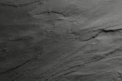 svart stentextur arkivbild