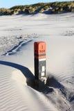 Svart strandpol I 200, Ameland ö, Holland Arkivfoto