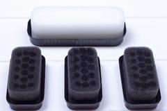 Svart svamp för omsorg av footweaen arkivfoton