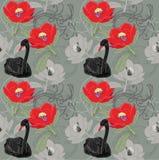 Svart svan och röda blommor Royaltyfri Foto