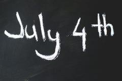 Svart svart tavla i klassrum th 4 av Juli Arkivbild
