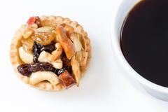 Svart syrliga kaffe och frukt Royaltyfri Bild
