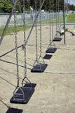 svart töm vertikala swings Arkivfoton