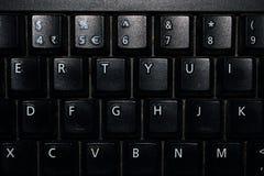 Svart tangentbord med alfabet och nummer royaltyfri fotografi