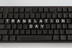 Svart tangentbord på vit bakgrund Inskriften på knapparna - översättningsdag Minsta begrepp arkivbild