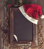 Svart tavla för meny i en julatmosfär Arkivbild