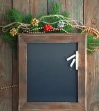 Svart tavla för meny i en julatmosfär Royaltyfri Fotografi