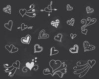 Svart tavla med hjärtavektorn Arkivbild