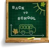 Svart tavla med skolbussen och uttryck tillbaka till skolan Fotografering för Bildbyråer