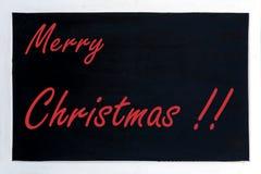 Svart tavla som annonserar glad jul arkivbilder