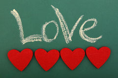 Svart tavlaförälskelse med fyra hjärtor Arkivfoton