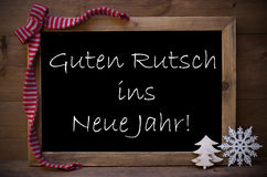 Svart tavlaGuten Rutsch för jul Ins Neue Jahr betyder nytt år Arkivfoton