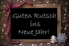 Svart tavlaGuten Rutsch Ins Neue Jahr betyder det nya året, snöflingor Royaltyfri Fotografi