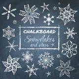 Svart tavlauppsättning av snöflingor Fotografering för Bildbyråer