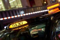Svart taxitecken Fotografering för Bildbyråer