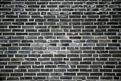 svart tegelstenvägg Fotografering för Bildbyråer
