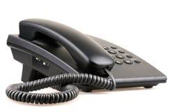 Svart telefon som isoleras på vit bakgrund Arkivfoton