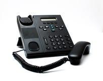 Svart telefonlur och en telefon Fotografering för Bildbyråer