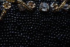 Svart textur av pärlor Storen specificerar! arkivfoto