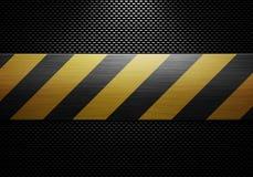 Svart texturerad materiell design för kol fiber med varningsbandet in Arkivfoto