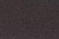 Svart texturerad pappers- bakgrund Royaltyfria Bilder
