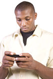 svart tillfällig cell hans mantelefon som texting Royaltyfri Bild