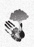 Svart trädkontur på handprint Arkivfoto