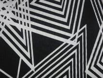 Svart tygtextur med vinkelformiga vita linjer Royaltyfri Bild