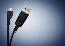 svart usb för kabel två Arkivbilder