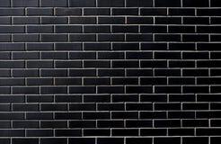 Svart vägg för tegelsten klassisk facade Fotografering för Bildbyråer