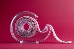 Svart vinbär Sugar Candy Ribbon i tejphållare royaltyfria foton
