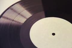 Svart vinyl som isoleras på vit Arkivbilder