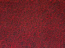 Svart virvel för textur för modell för golv för röd matta Arkivfoton