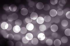 Svart vit glödande ljus Bokeh borste- och tapetbakgrund Royaltyfri Bild